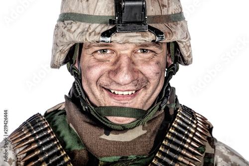 Valokuva  Close up studio portrait of friendly looking marine, military veteran with dirt