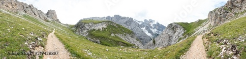 Panorama view of mountains and  a hiking trail near Sciliar #219426897