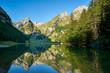 canvas print picture - Blick auf Alpsteinmassiv mit Säntis, Spiegelung der Berge im Seealpsee, Bergwald, blauer Himmel