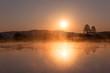 Misty Golden Sunrise Reflecting over Lake in Spring.