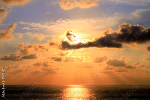Fotografie, Obraz  Gladiator Shape Tropical Clouds and Sunset over Acapulco Bay .