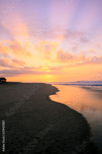 Tropical Sunrise over Pacific Ocean Sandy Beach in Mexico.