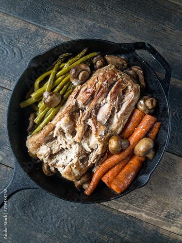 Fotografie, Obraz  Cast iron with pork roast carrots and asparagus