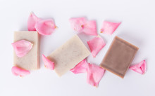 Top View Of Handmade Soap With Flower Petals On White Background