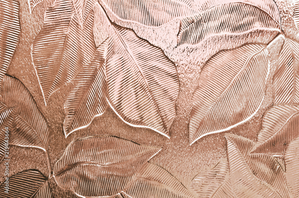 Fototapeta Leaf pattern embossed glass tinted peach pink