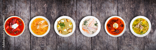 Set of soups from worldwide cuisines, healthy food. Cream soup with mushrooms, asian fish soup, soup with meat
