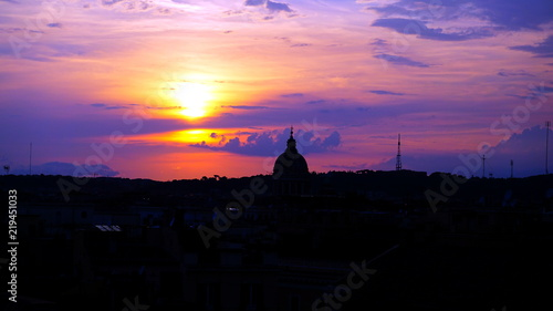 Poster Rome View of a Roman sunset from an elevated terrace on a summer afternoon with cloudy sky