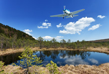 Exploring The Wilderness - Small Aircraft Flying Above Scenic View