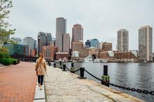 Girl In Harborwalk, Seaport, Boston, Massachusetts, USA.