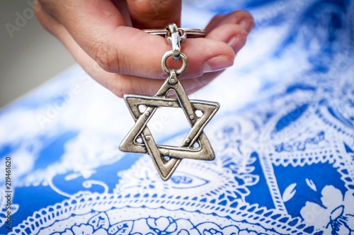 Young woman's hand holding a Star of David - Magen David key chain Canvas Print