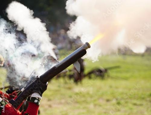 Fotografie, Obraz Ancient matchlock gun firing, lots of smoke