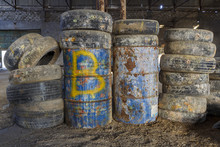 Old Tires And Barrels In An Abandoned Hangar