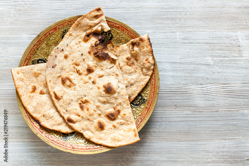 Tandoori Roti whole wheat flat bread on gray table