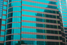 Office Buildings, Modern Glass Skyscrapers, One Is Reflected In Another. Urban Environment, Architecture Theme.