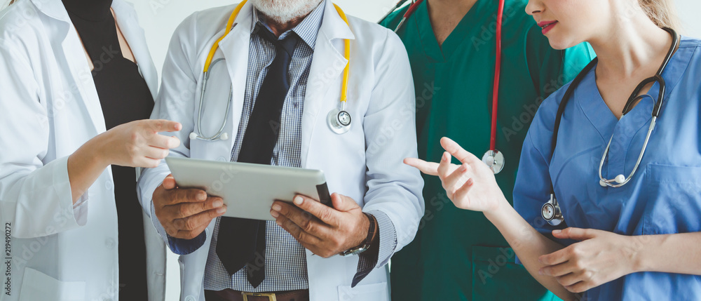 Fototapety, obrazy: Group of doctor with tablet on white background