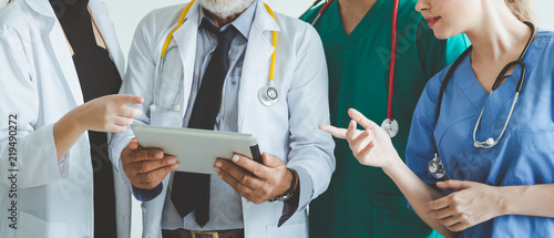 Valokuva  Group of doctor with tablet on white background