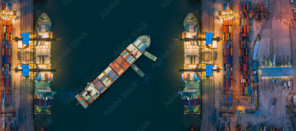 Fototapeta Aerial view container ship from sea port working for delivery containers shipment. Suitable use for transport or import export to global logistics concept.