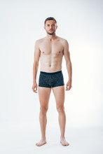 Full Length Portrait Of A Young Sexy Muscular Male Model In Underwear