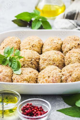 Healthy oven baked chicken rissoles on baking dish, ready for cooking Canvas Print