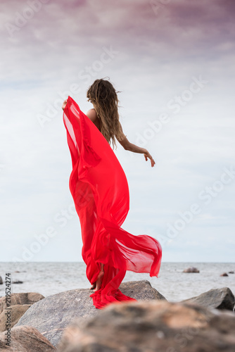 Tuinposter Akt Young woman posing at the beach