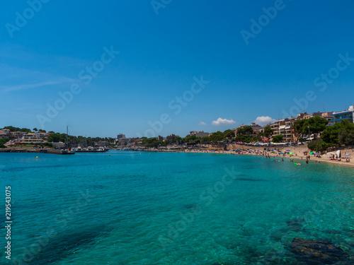 Photo Stands Algeria Beach harbor and houses of Porto Cristo Mallorca