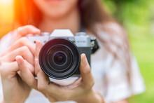 Closeup Front Lens Of Mirrorless Camera In Woman Teen Photographer