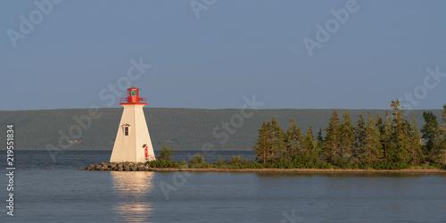 Foto op Aluminium Vuurtoren Kidston Island Lighthouse at twilight in Baddeck, Nova Scotia