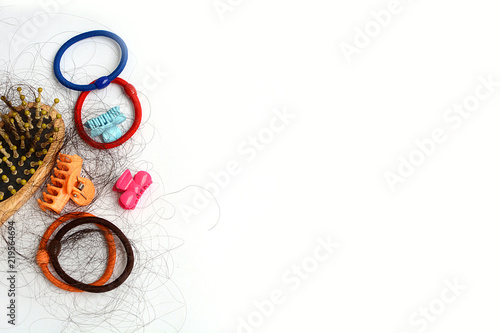 Photo Hair loss, hair fall everyday serious problem, girl with a comb and problem hair on white background