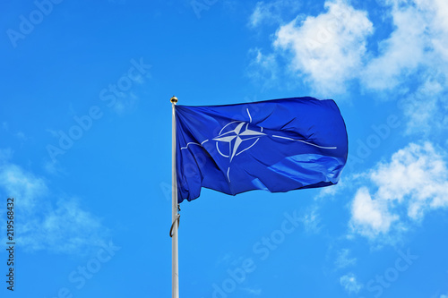 Photo  Flag of NATO waving in wind