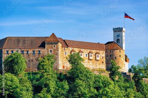 Old castle tower Slovenian flag on hill Ljubljana Slovenia