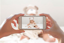 Woman Photographing Her Baby W...