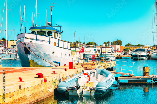 Photo Stands Turquoise Boats and Villasimius Marina in Mediterranean Sea Sardinia Island Italy