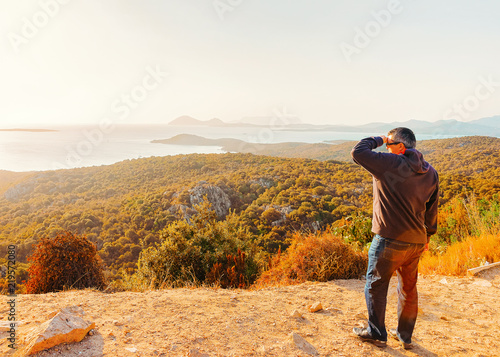 Man looking at Mediterranean Sea in Costa Smeralda Sardinia Italy Canvas Print