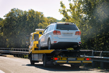 Tow Truck With Broken Car On R...