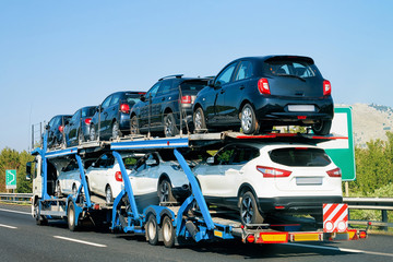 Cars carrier at road