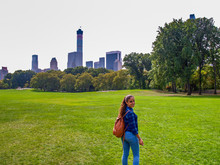 Young Girl Posing At Sheep Meadow In Central Park, NY, New York, USA