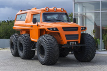 Orange Wheeled Off-road Vehicle On Ultra-low Pressure Tires Outdoor