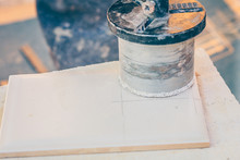 Finishing Works - The Tiler Cuts The Tile With A Diamond Crown