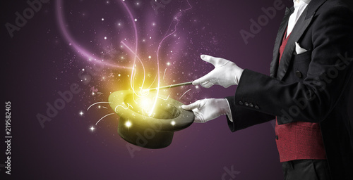 Canvastavla Magician hand conjure with wand  light from a black cylinder