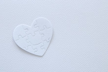 Top View Image Of Paper White Heart Puzzle. Health Care, Donate, World Heart Day And World Health Day Concept.