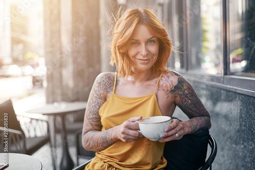 beautiful tattooed ginger girl in cafe - 219585830