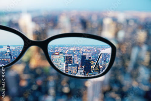Foto op Canvas Stad gebouw Close up of glasses in city