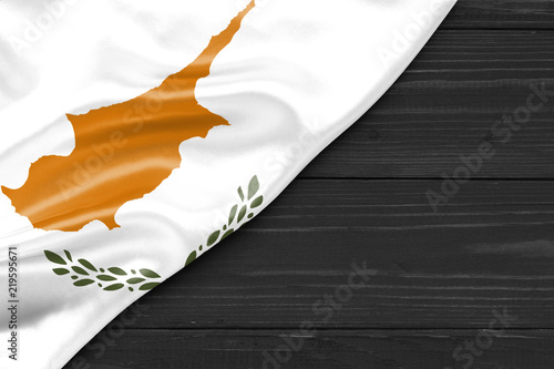Flag of Cyprus and place for text on a dark wooden background