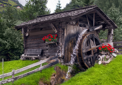 Water mill in a picturesque place among the forest
