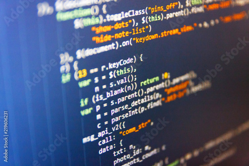 Writing programming code on laptop  Software source code