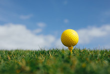 Yellow Golf Ball On Tee, Green...