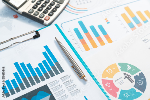 Obraz charts. Business reports and pile of documents on gray reflection background - fototapety do salonu