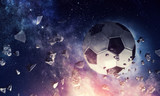 Fototapeta Sport - Soccer ball in cosmos