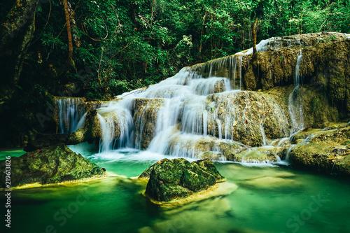 Beautiful waterfall in the rain forest jungle of thailand. Erawan waterfall in Erawan National Park, kanchanaburi,Thailand
