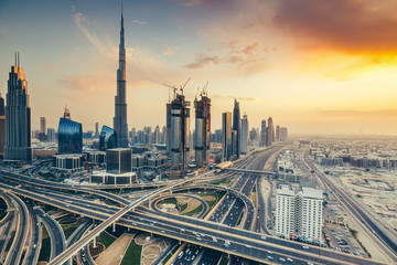 Scenic view on downtown Dubai, United Arab Emirates at sunset. Colourful travel background.